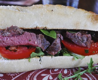 Steak Sandwich with Arugula and Fresh Herb Topping