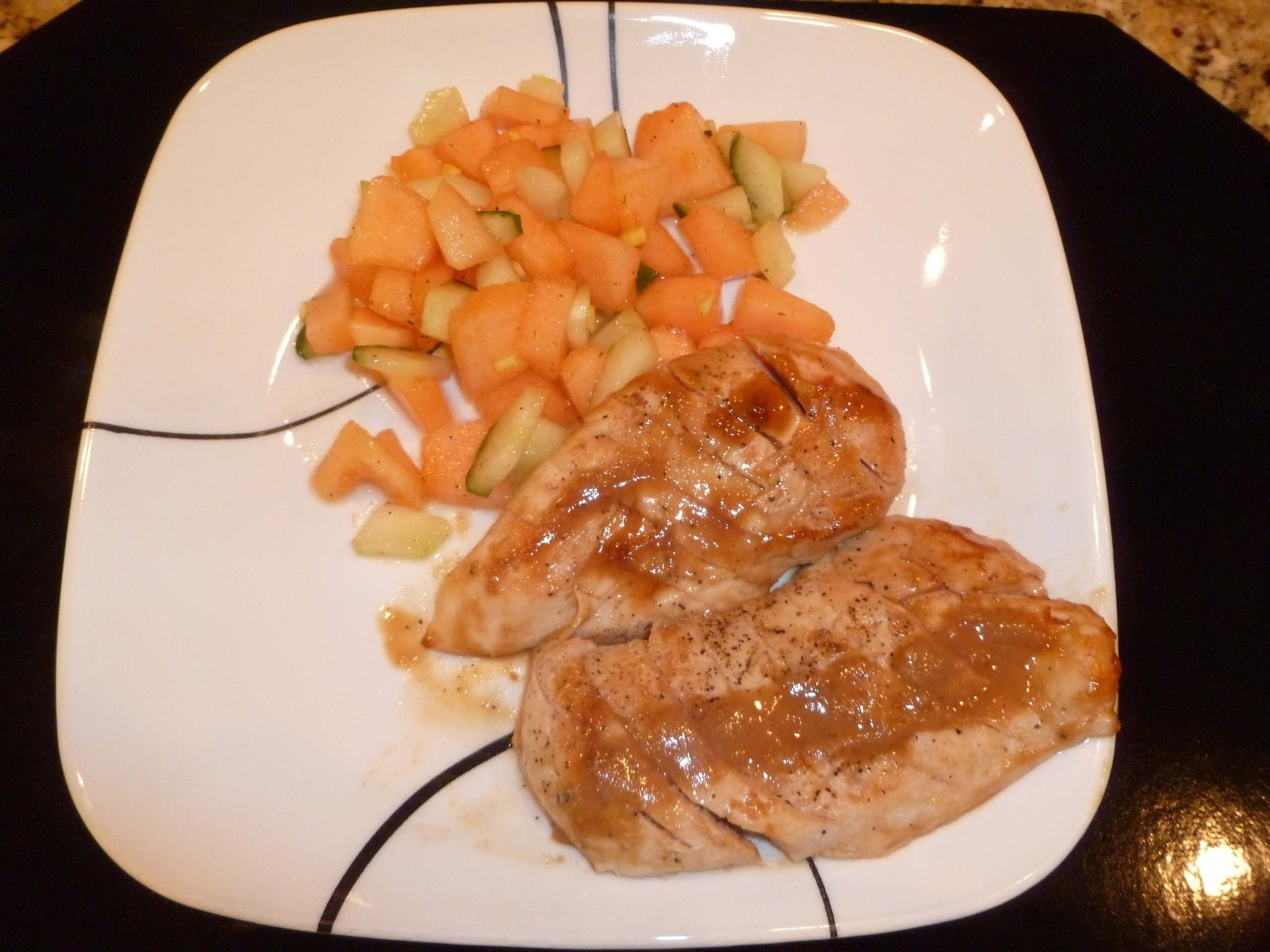 Grilled chicken with cucumber/melon relish and peanut sauce
