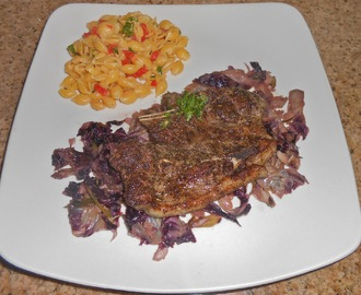 Herb Crusted Lamb Blade Steak on Braised Radicchio with Roasted Red Pepper Parmigiana Quinoa Pasta Shells