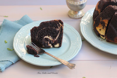 Cheesecake Swirled Dark Chocolate Carrot Cake