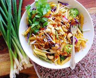 Vegetables and noodle salad with spicy peanut butter dressing