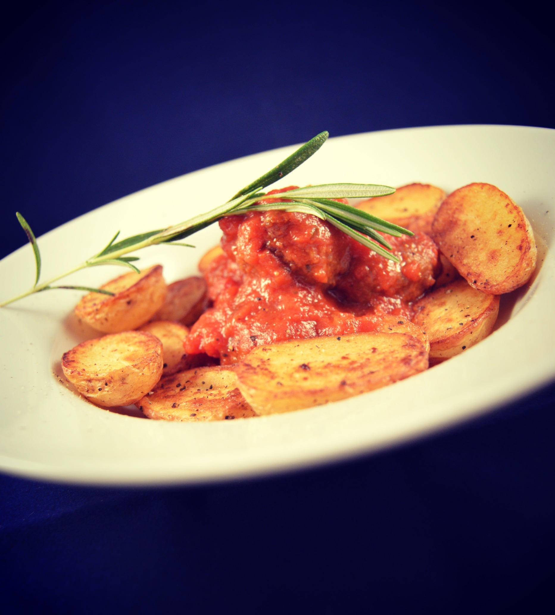 Beef meatballs with tomato sauce and baby potatoes