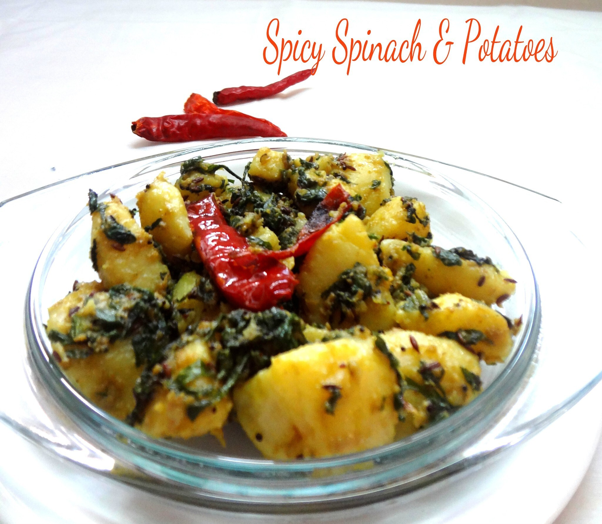 Spicy Spinach  and Potatoes tossed in Indian spices ( Aaloo Paalak)