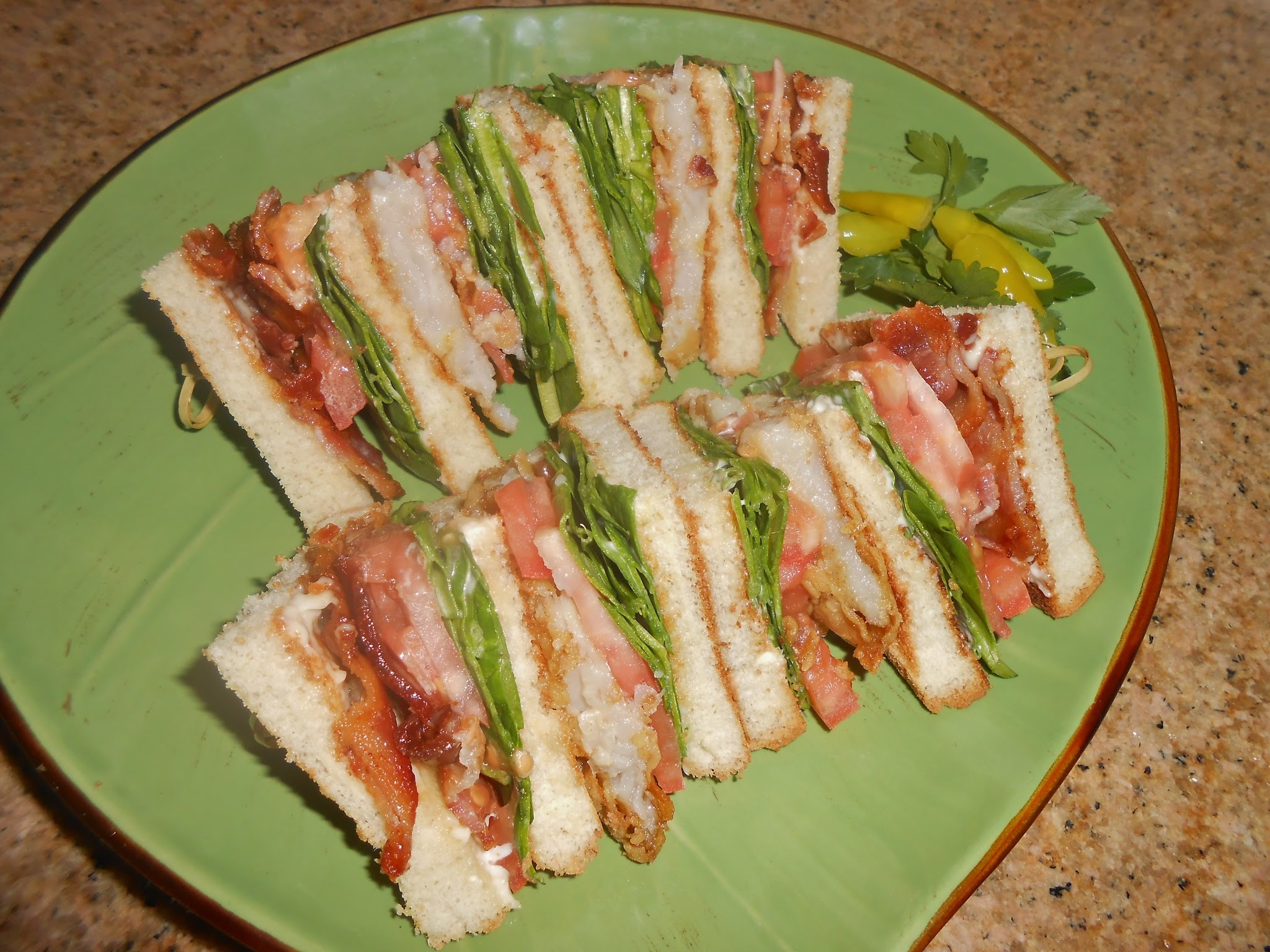 Club Sandwich of Pan Fried Swai, Spinach and Smoked Bacon
