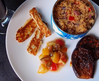 Harissa and honey roasted aubergines with tomato salsa, halloumi and spicy couscous