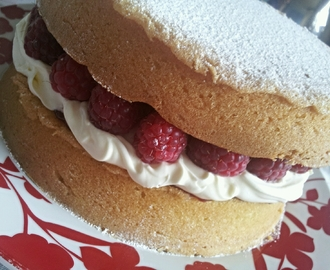 Victoria Sponge with fresh raspberries and cream