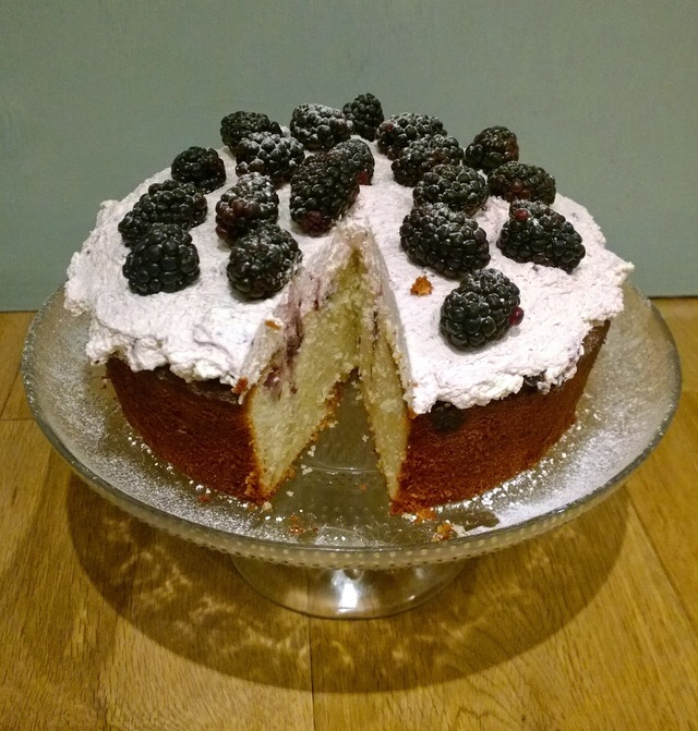 Ricotta, lemon, almond and blueberry cake with blackberry cream