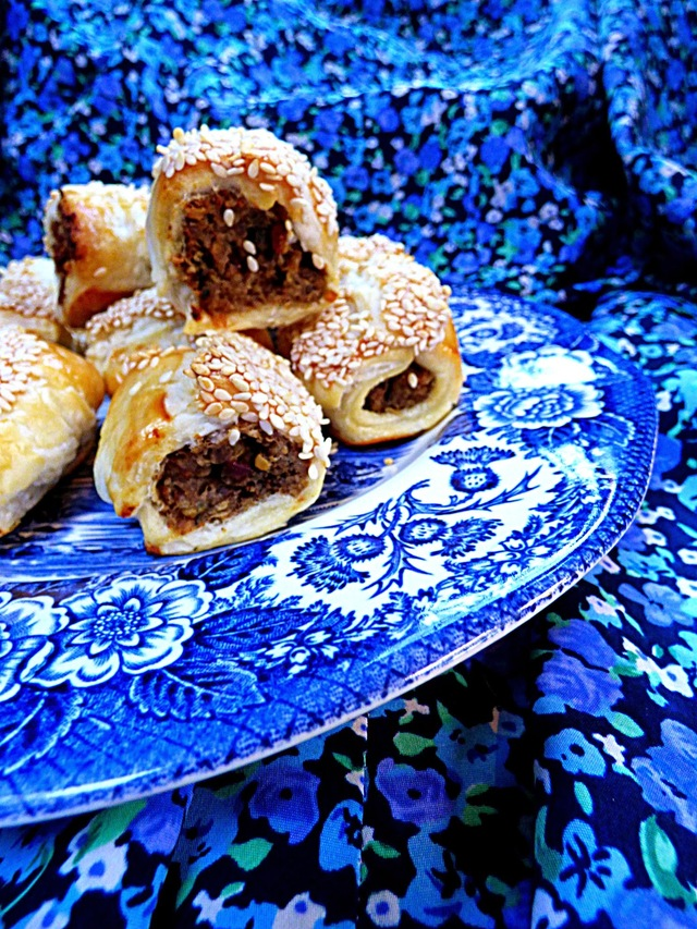 Haggis sausage rolls with cranberries and sesame seeds