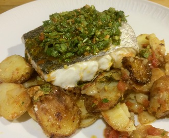 Roast hake with chermoula on a bed of new potatoes and tomatoes