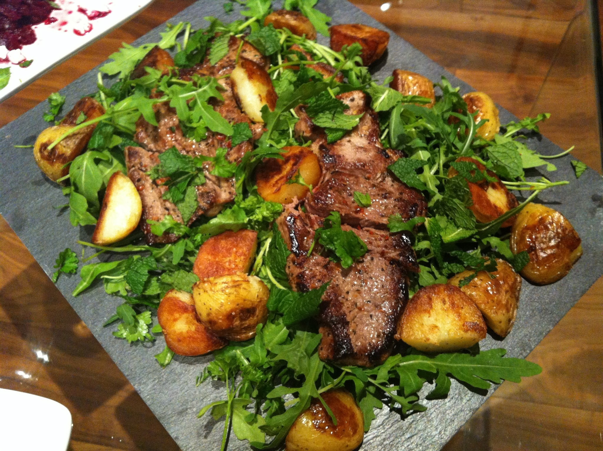 LoveBites Lamb Steaks served with Roast Potato Bites and a Rocket Salad