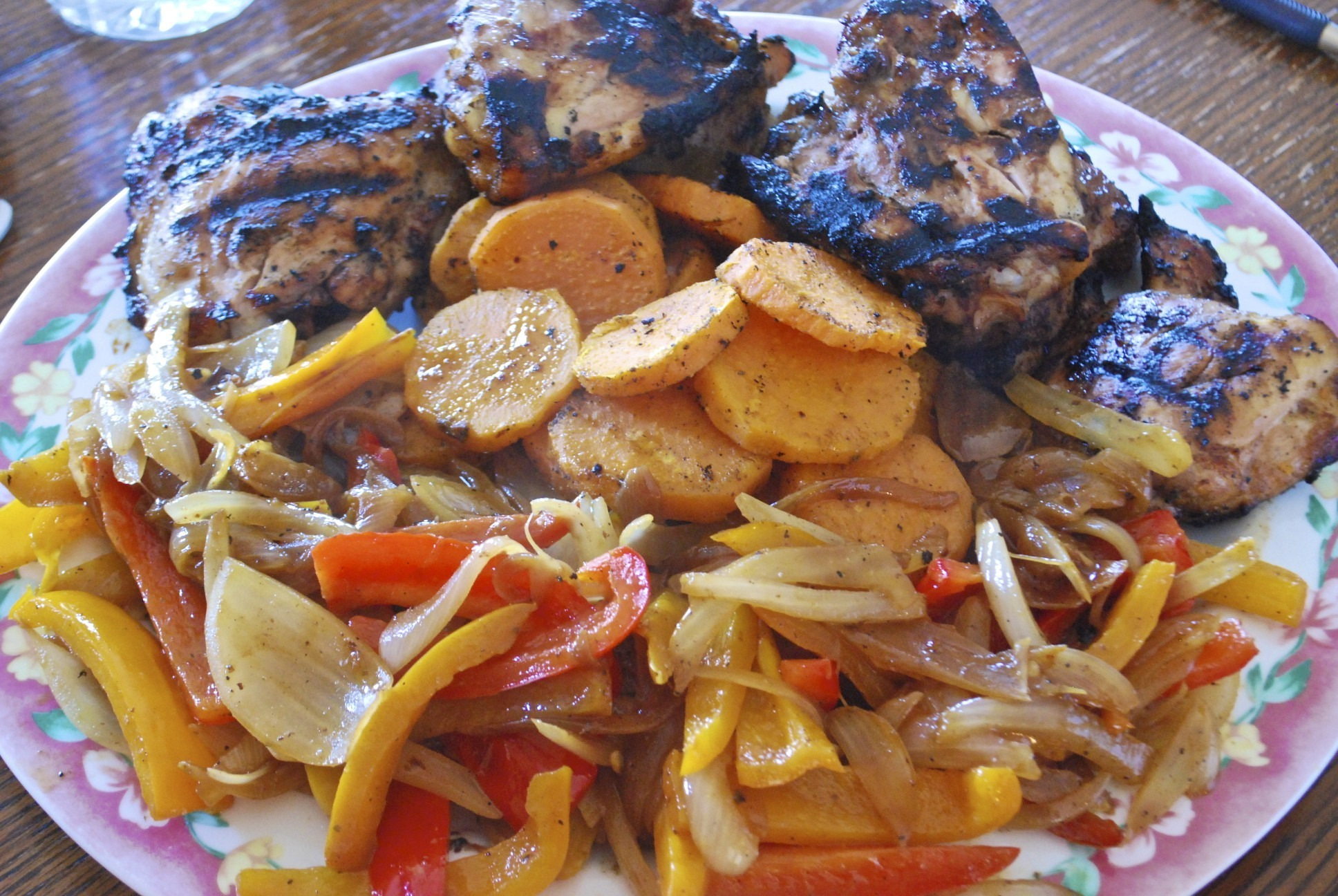 Grilled Marinated Chicken Thighs with Grilled Sweet Potato and Sauteed Peppers and Onions