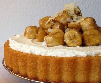 white cake with whipped cream frosting and cinnamon sauteed bananas.