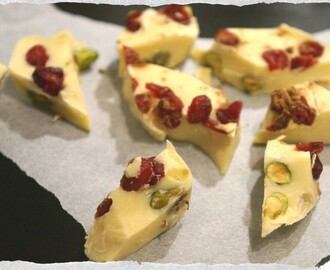 Homemade Chocolate bark with pistachios, dried cranberries and licorice powder