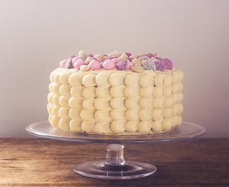 Walnut cake with marshmallow fluff, salted vanilla buttercream and sugared almonds