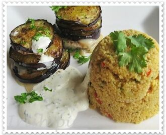 Baked goat cheese with eggplant on vegetables couscous / Gebackener Ziegenkäse mit Auberginen an Gemüse Couscous