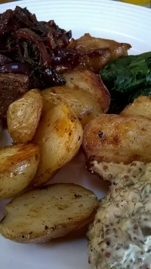 Pork chops with honey glazed onions, and pan roasted potatoes with a mustard and sage sauce