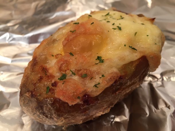 Breakfast baked jacket potato with egg and cheese