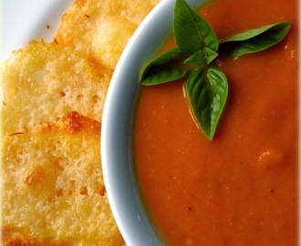 Homemade Tomato Soup with a hint of Basil served with Parmesan Crisps