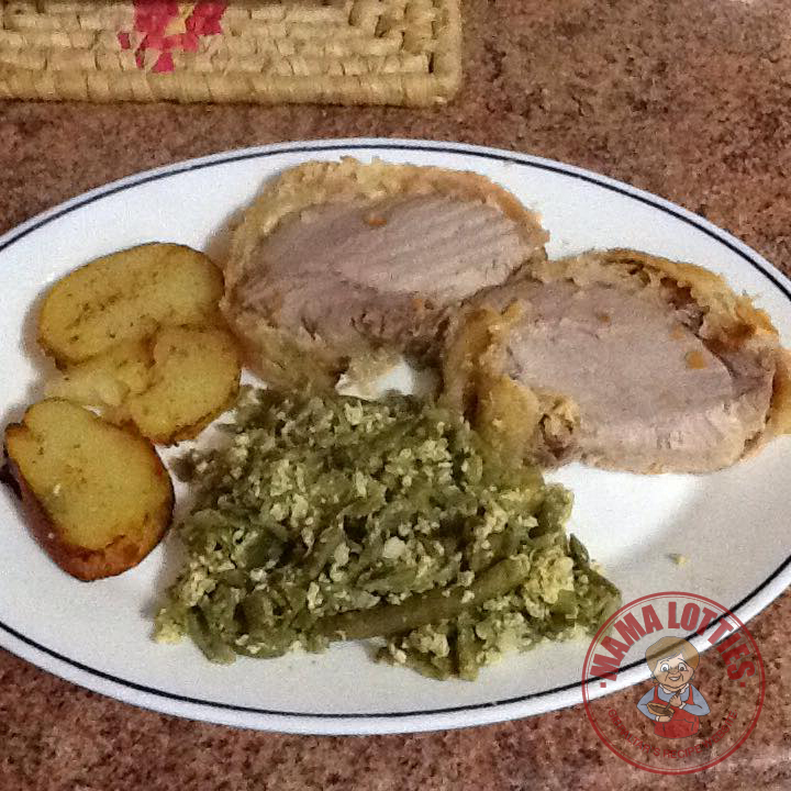 Pork loin wrapped in cheese, ham and puff pastry served with potatoes and scrambled egg and green beans.