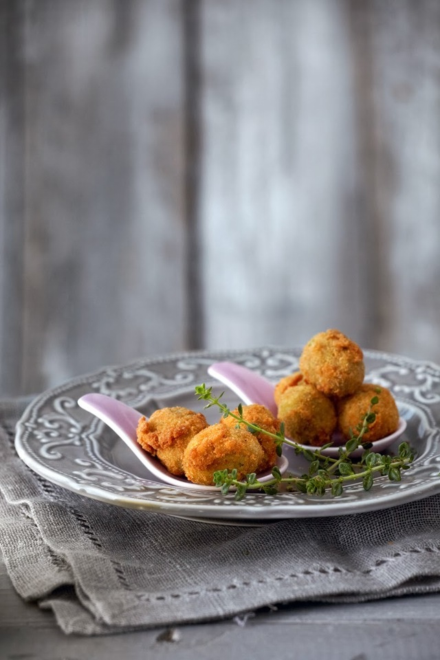 Spicy fried green olives stuffed with herbs and Feta cheese - Great, all-season appetizer!