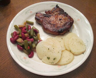Cast Iron Skillet Baked Pork Chop w/ Sliced New Potatoes, 3 Bean Salad, and…