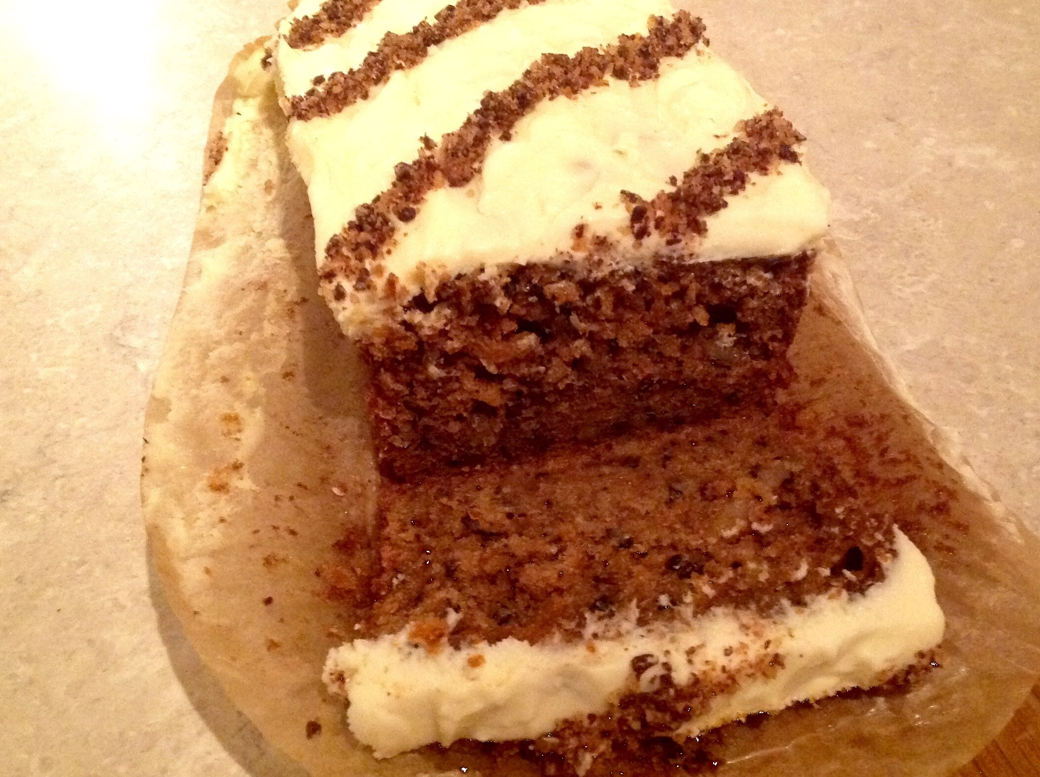 Gluten-free carrot cakes with white chocolate & cream cheese icing