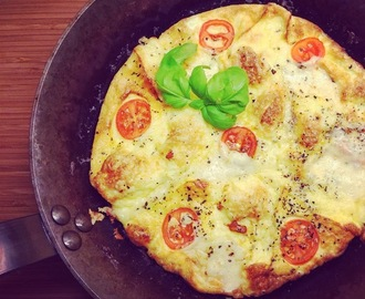 Cheesy omelette with tomato and basil