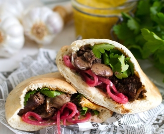 Meorav Yerushalmi a. k a Jerusalem mixed grill - Jerusalem street food classic of pita stuffed with offal and onion