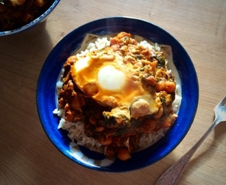 Chickpea and sweet potato curry with an egg poached inside it