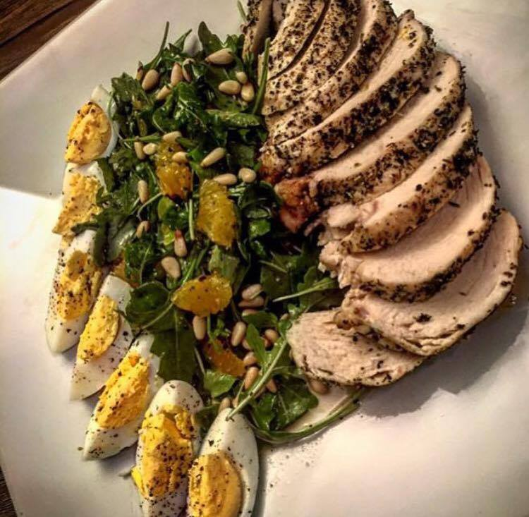 Arugula Salad with Homemade Orange Champagne Vinaigrette, Pinenuts, Baked Chicken Herbs De Provence and Hard Boiled Eggs