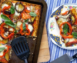 Cauliflower rice pizza crust with roasted vegetables