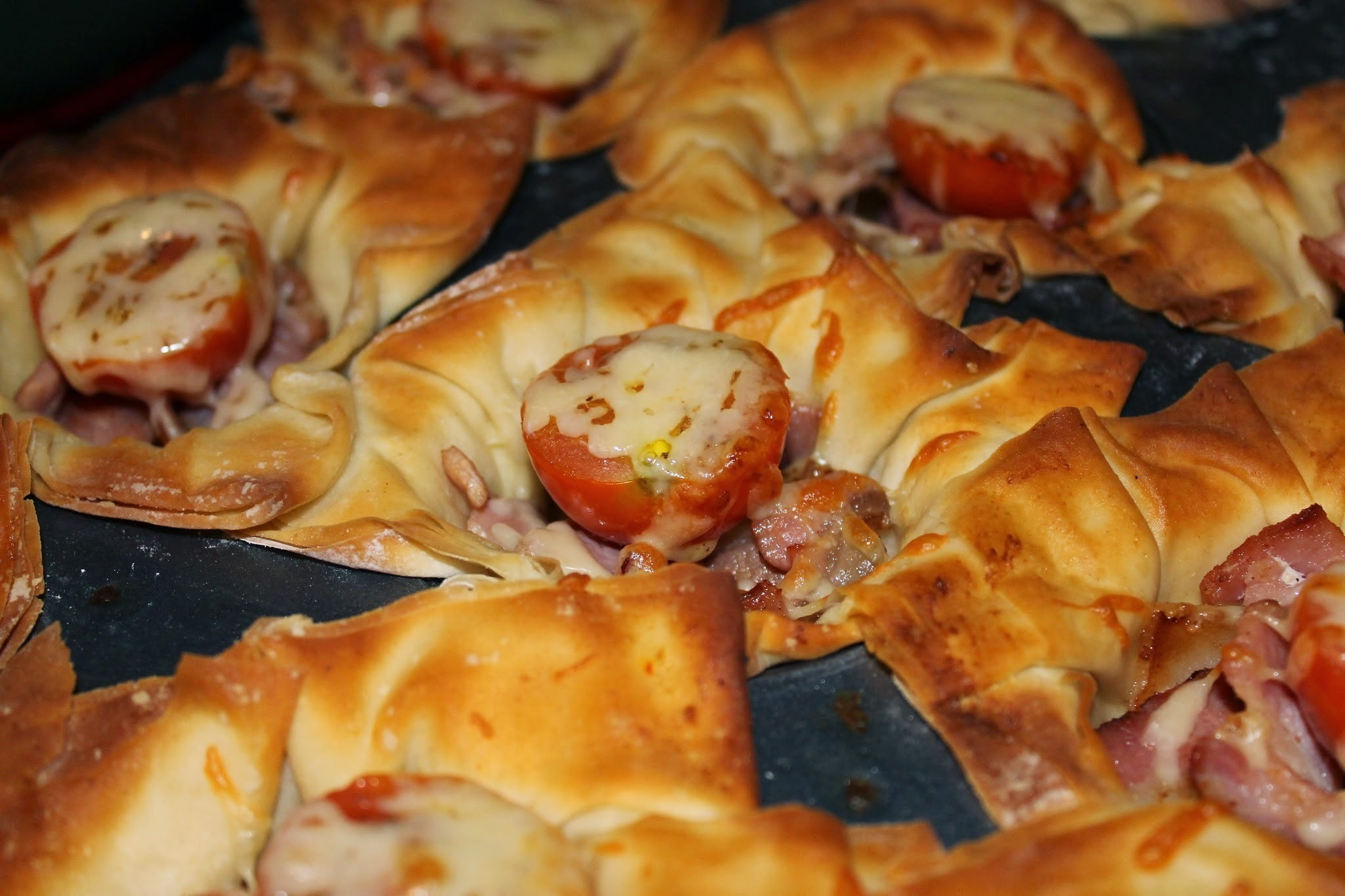 Bacon, cheese and tomato filo parcels