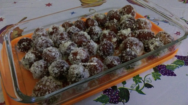 Gulab jamun coated with dessicated coconut
