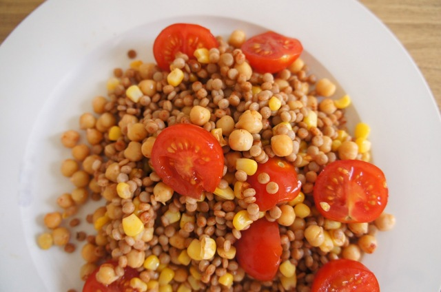 Giant couscous salad with chickpeas, sweet corn, paprika and tomatoes