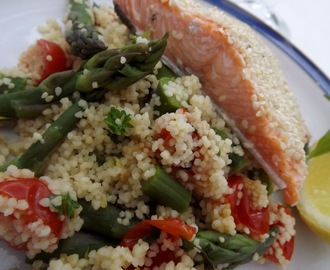Baked sesame coated Sea Trout with lemon,tarragon cous cous, asparagus & cherry tomatoes