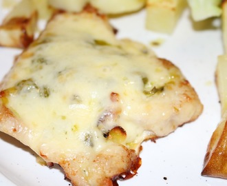 Baked turkey steaks with pesto and cheese