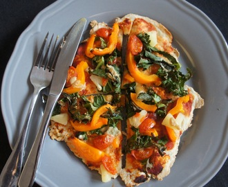 Vegan pizza with tahini, mint, sriracha and kale
