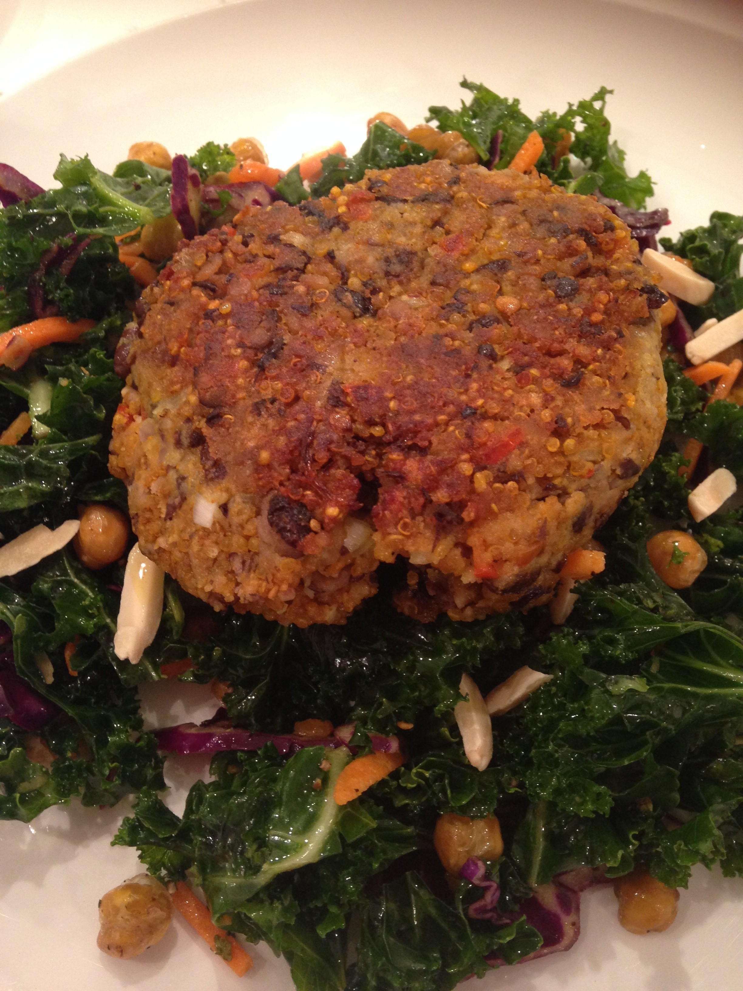 Spicy Black Bean Quinoa Burger on Baby Kale Salad with Lemon, Parmesan & Crispy Roasted Chickpeas
