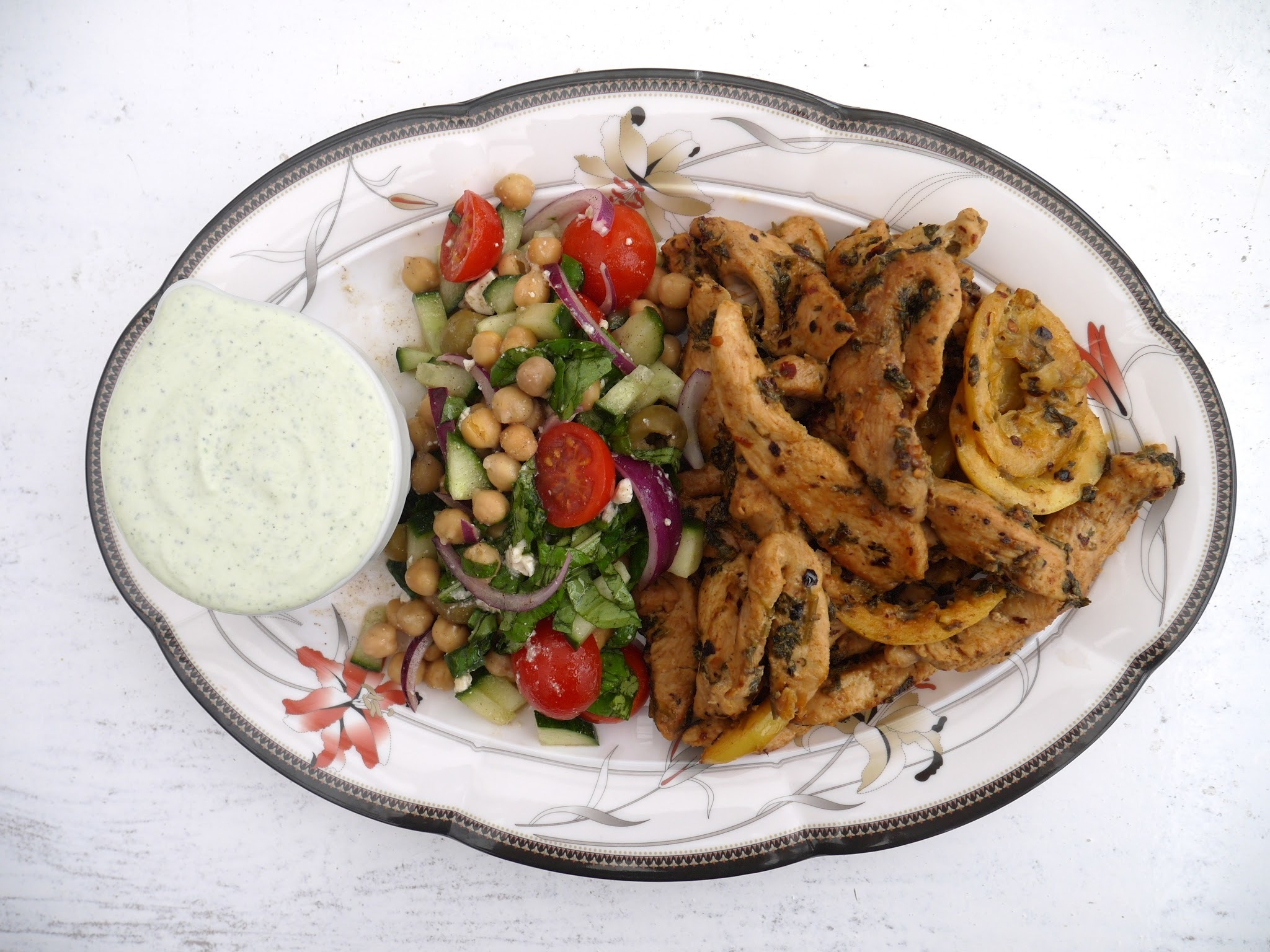 Chicken Marinated in Chilli Garlic Oil with Chickpea Greek Salad + Minty Greek Yoghurt.