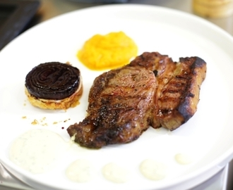 Rose veal rib eye steak with carrot and cumin puree, horseradish hollandaise and red onion tarte tatin...