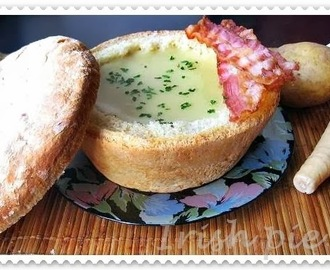 Creamy parsnip and potato soup in a bread bowl