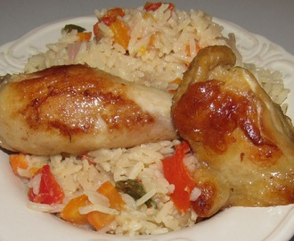 Coconut Rice as e dey hot! cooked with carrots, peppers and more