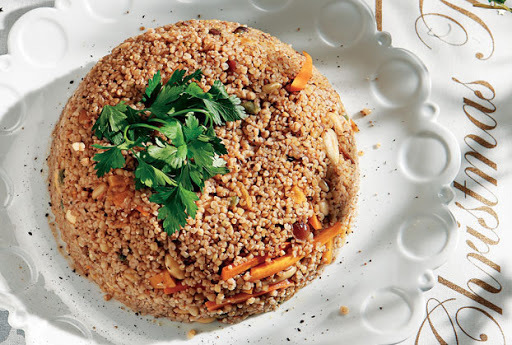 Christmas pilaf with bulgur, dried fruits and crunchy nuts