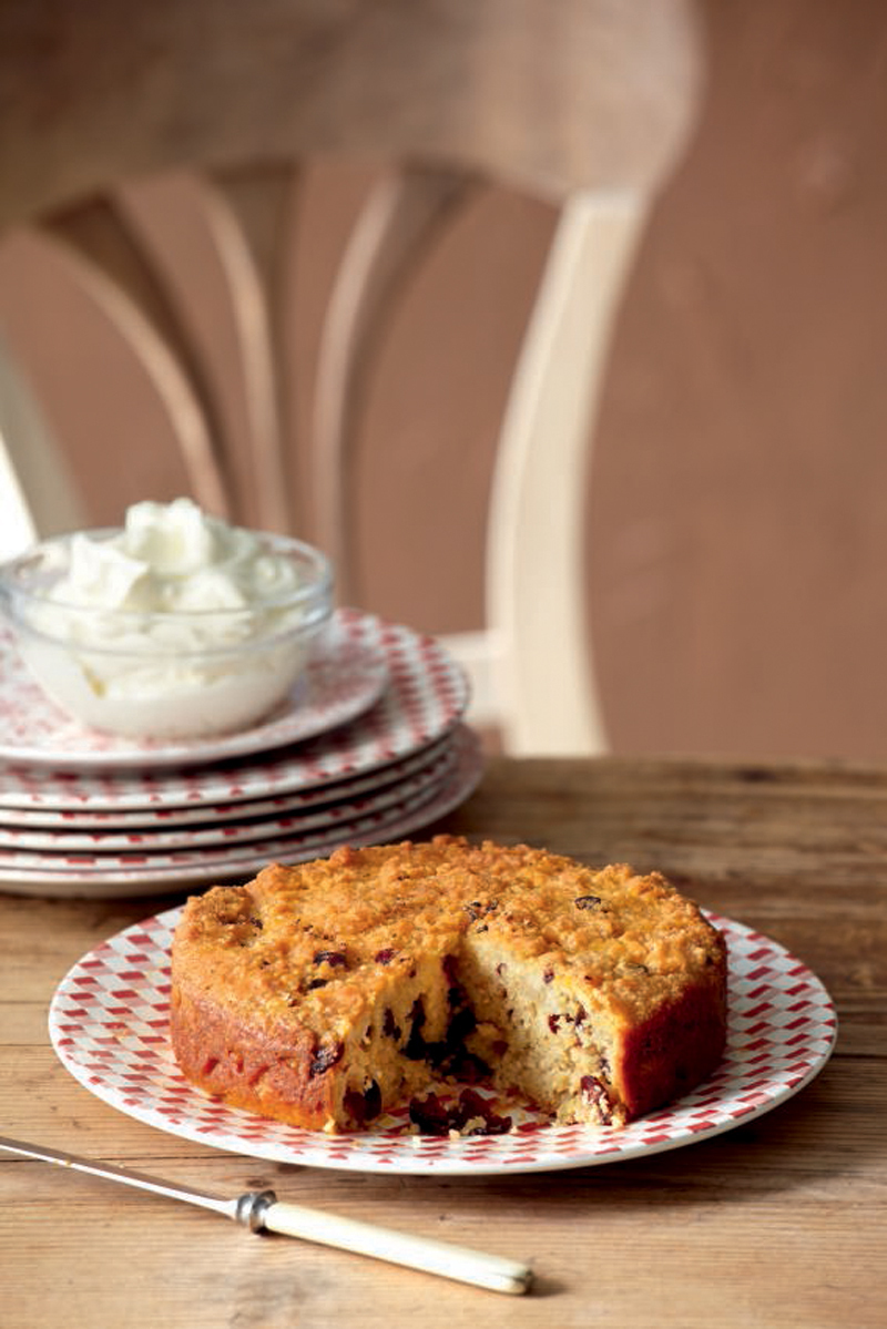 Fragrant raisins and almonds cake with syrup