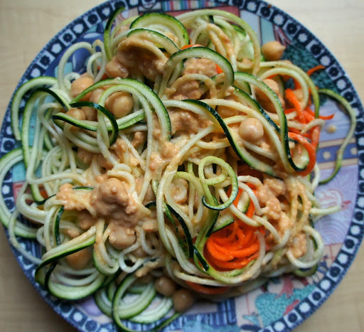 Raw zucchini noodles with a spicy peanut sauce