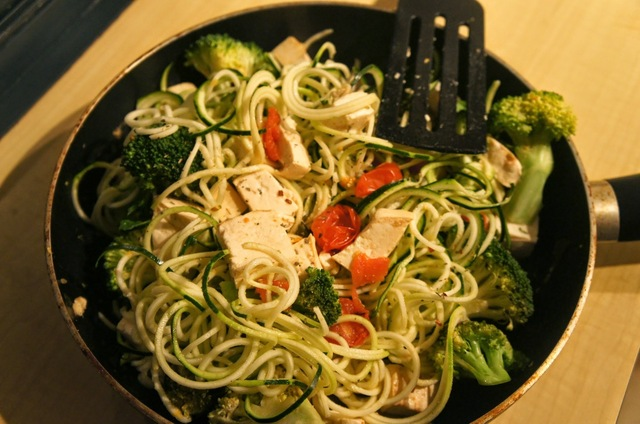 Lightly cooked zucchini noodles with a tomato basil sauce