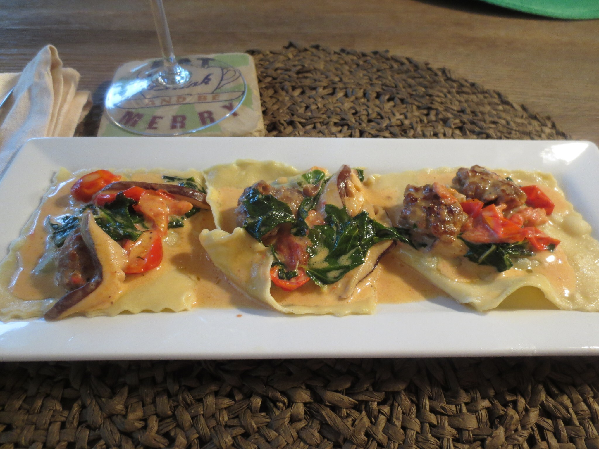 Kale and Mushroom Ravioli with Tomato White Wine Cream Sauce