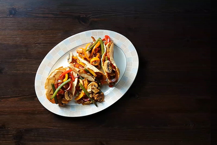 Vegetable stir fry with tacos