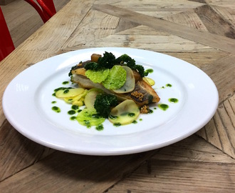 Roast fillet of sea bass, crispy kale, fondant potato, savoy cabbage rondure, truffle mayonnaise and parsley infused oil
