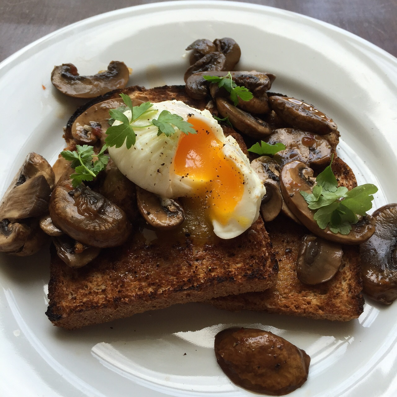 Sweet chilli mushrooms on toast with poached egg and parsley